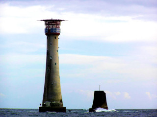 The current Eddystone lighthouse alongside the stub of its progenitor.