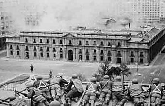 Troops outside the burning presidential palace.